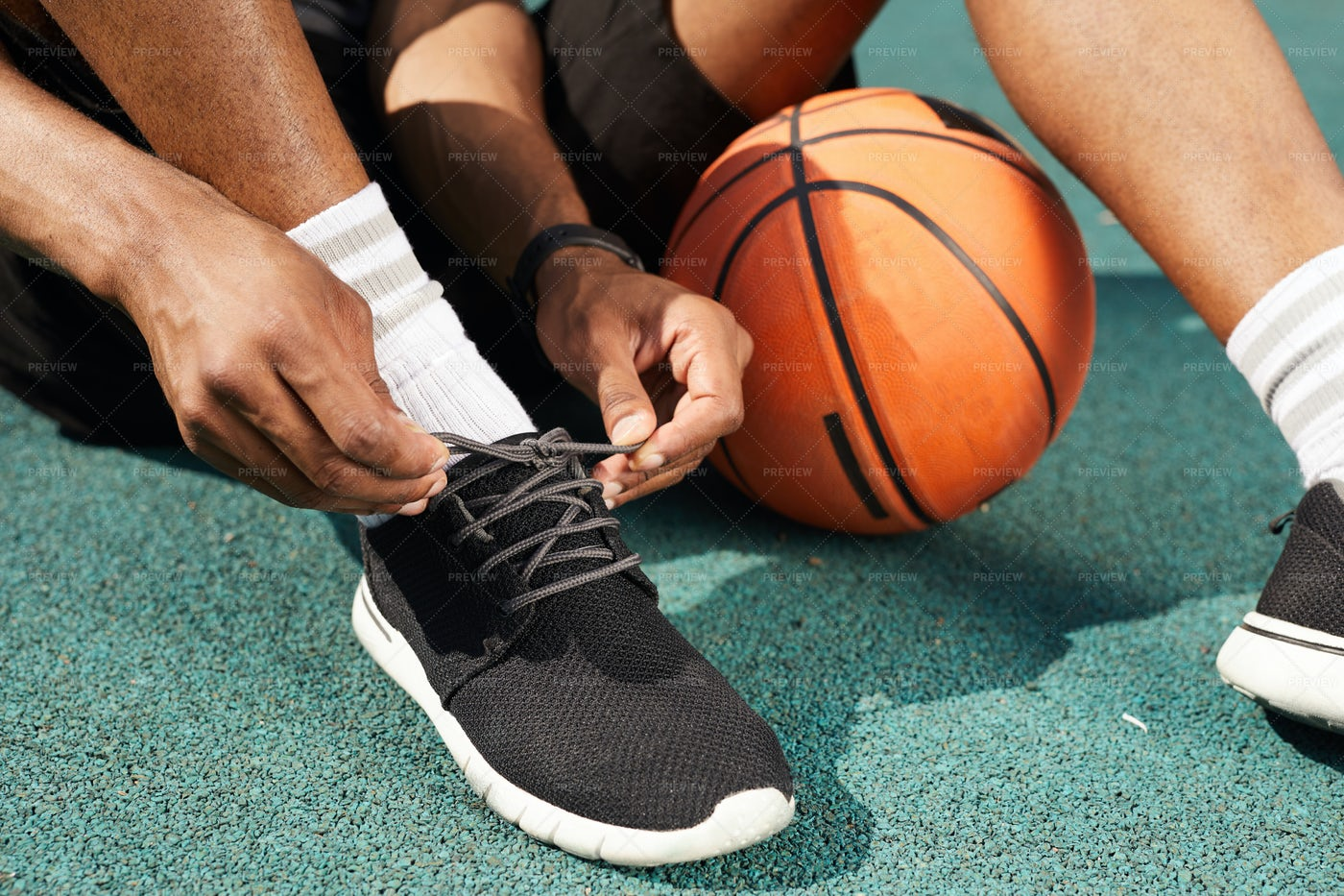 African Sportsman Tying Shoes: Stock Photos