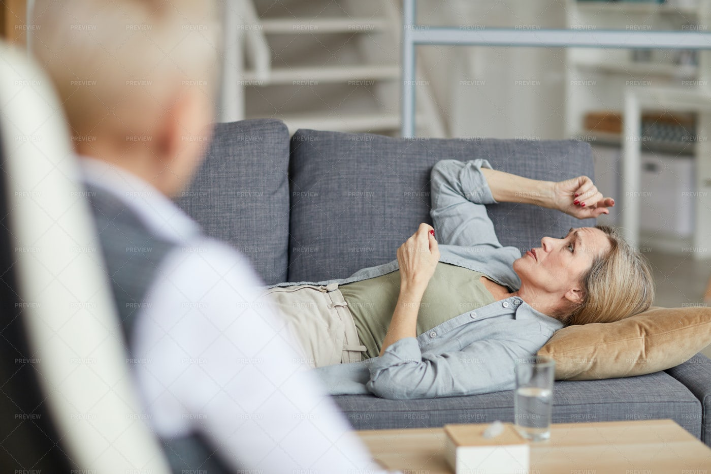 Lying On Couch In Therapy: Stock Photos