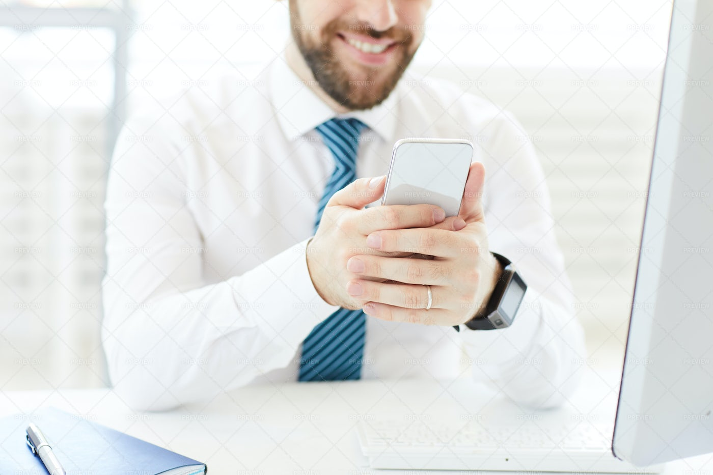 Watching Video On Smartphone: Stock Photos