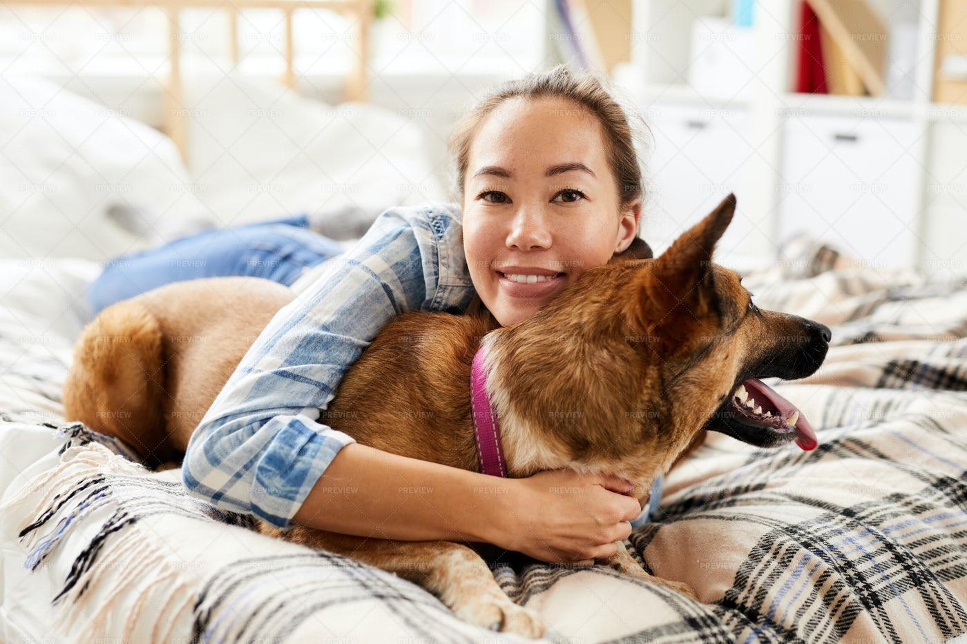 Asian Woman Hugging Dog: Stock Photos
