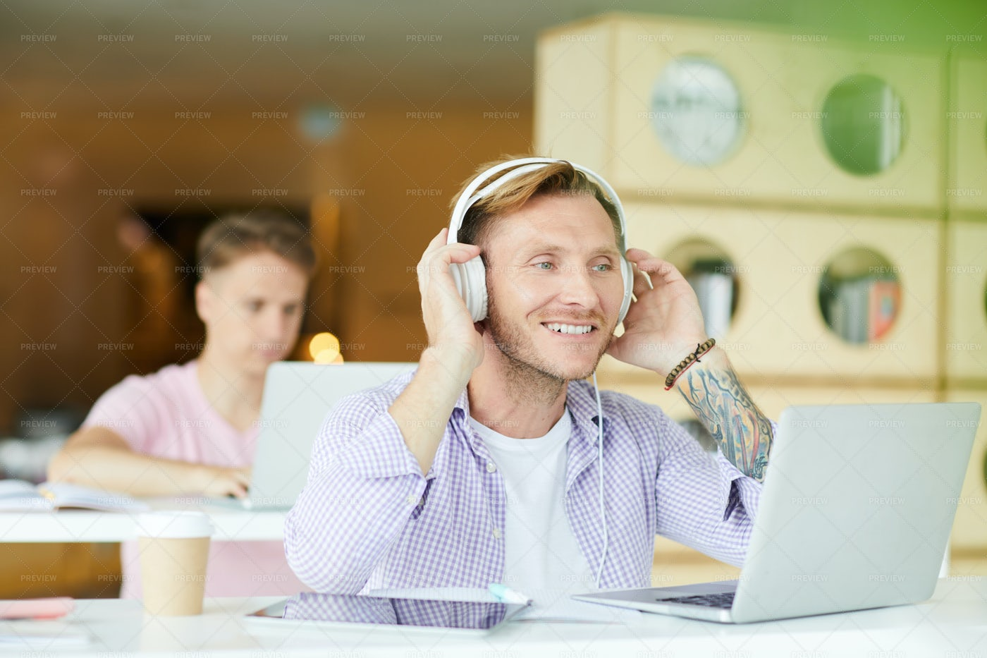 Positive Guy In Headphones Working...: Stock Photos