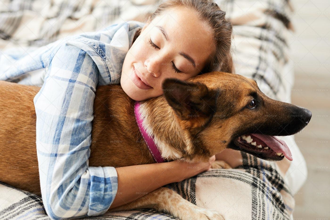 Asian Woman Embracing Dog: Stock Photos