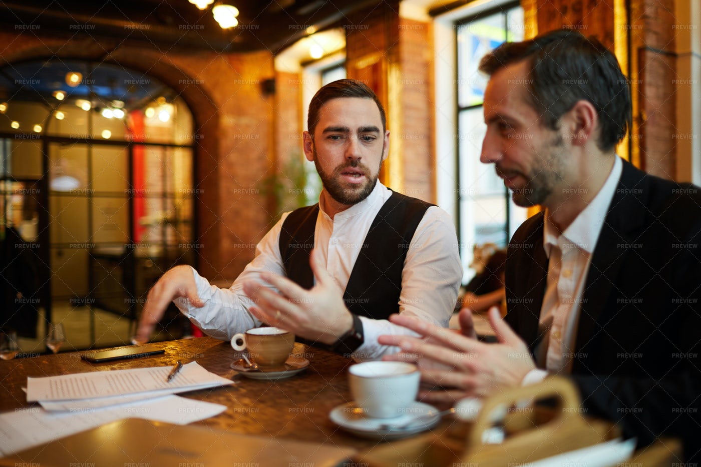 Two Business People Meeting In...: Stock Photos