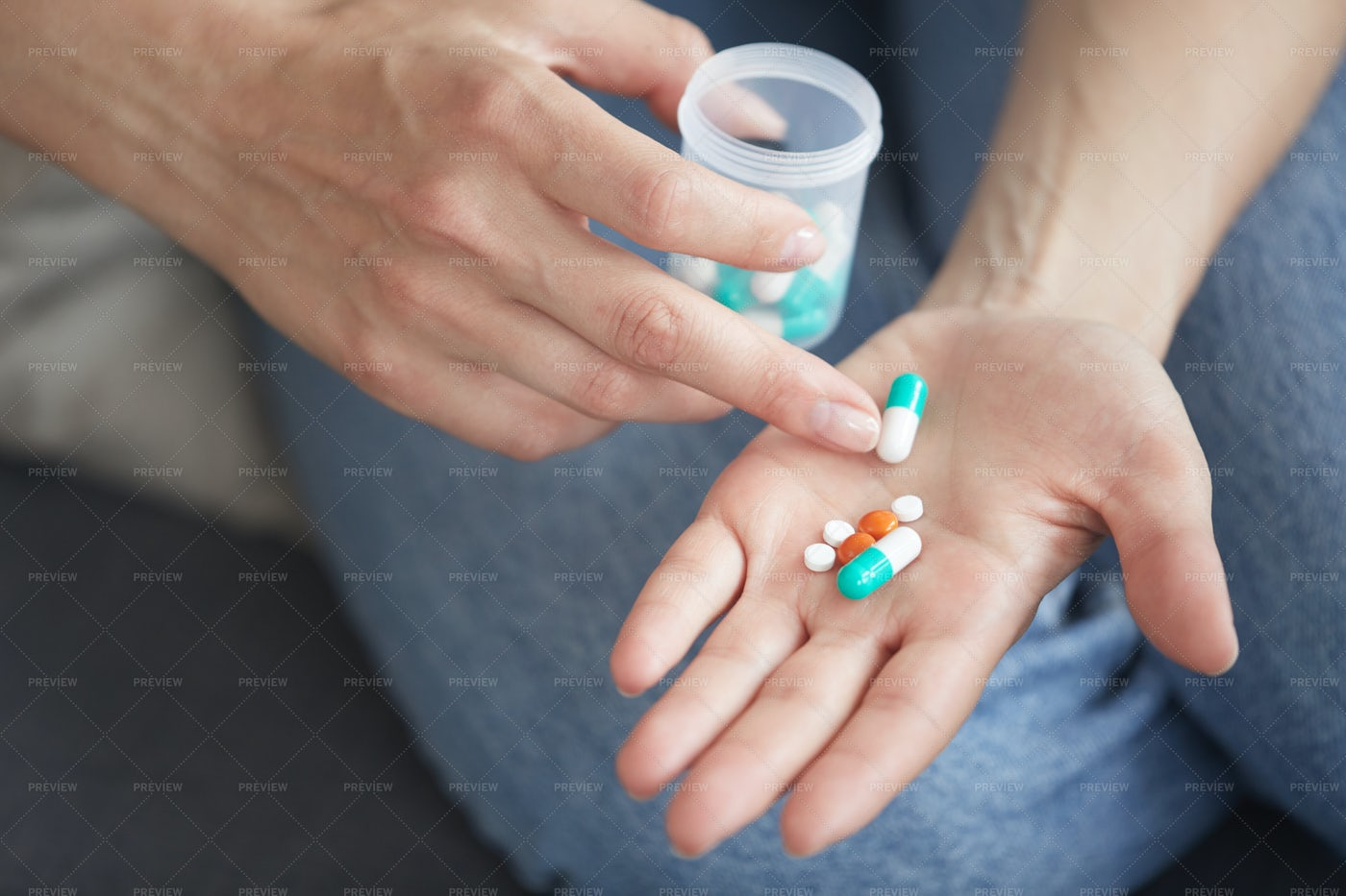 Counting Pills On Palm: Stock Photos
