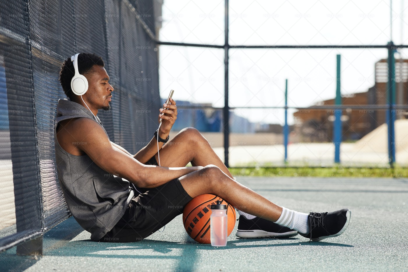 African Guy Relaxing In Spots Court: Stock Photos