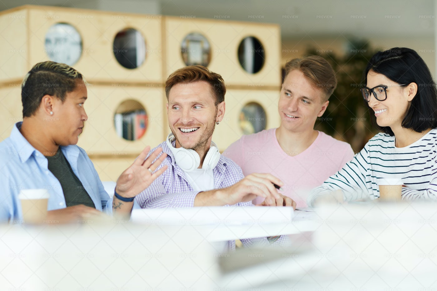 Cheerful Students Exchanging Ideas: Stock Photos