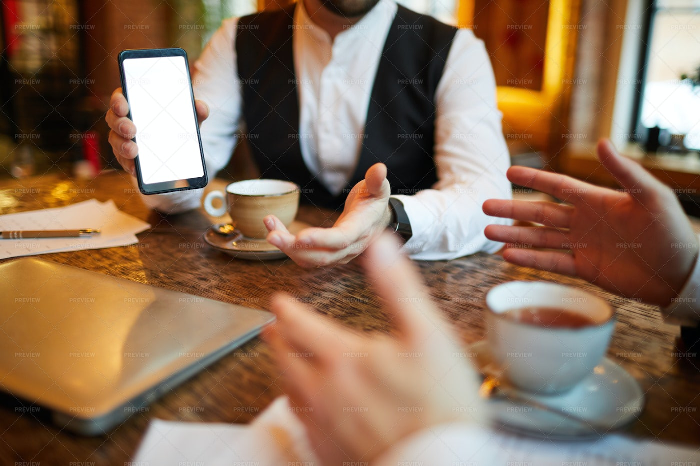 Businessman Showing Mobile App: Stock Photos