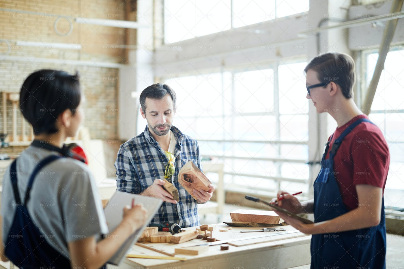 Skilled Carpenter Holding Class For...: Stock Photos