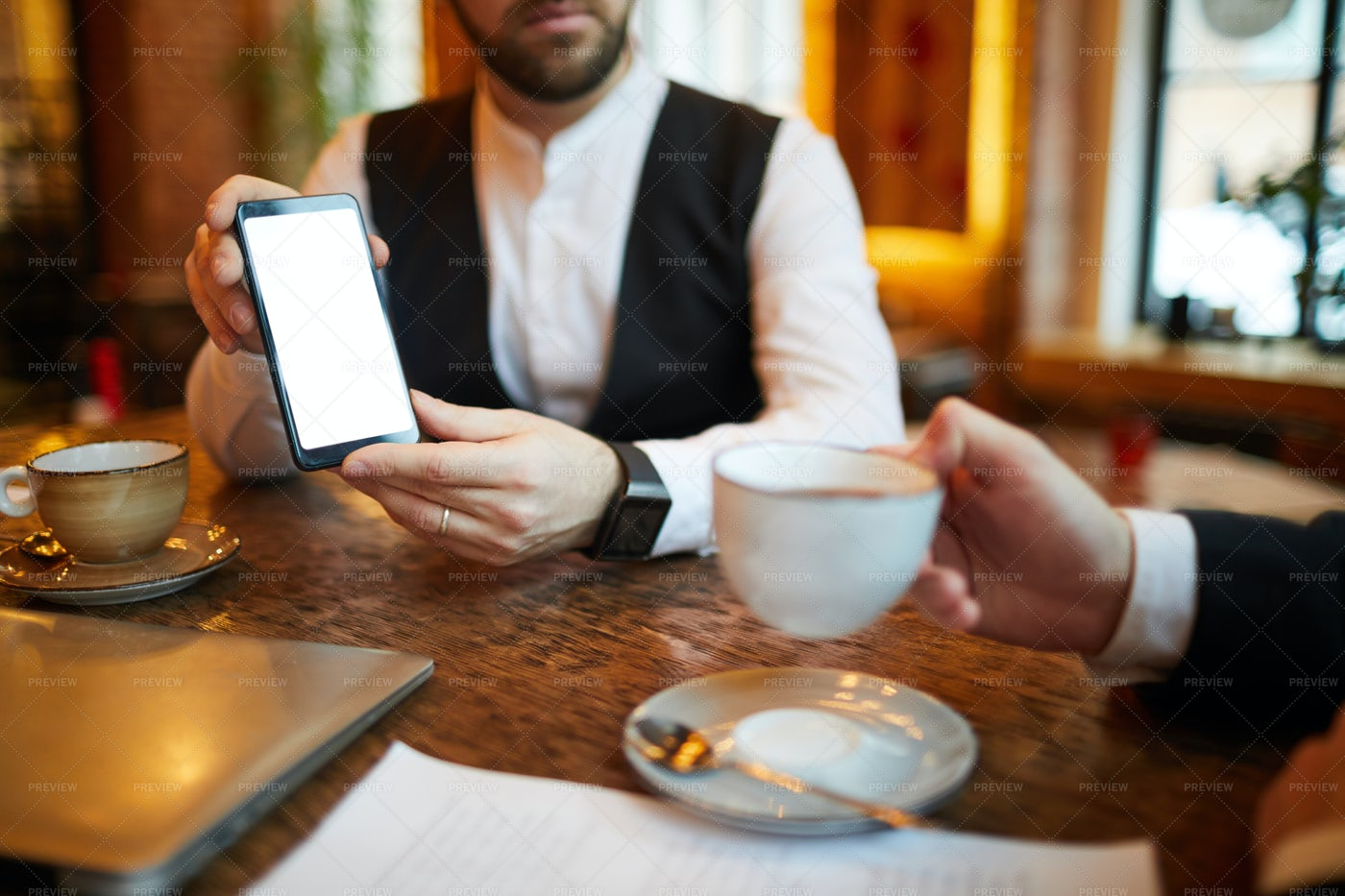 Businessman Showing Mobile Phone: Stock Photos
