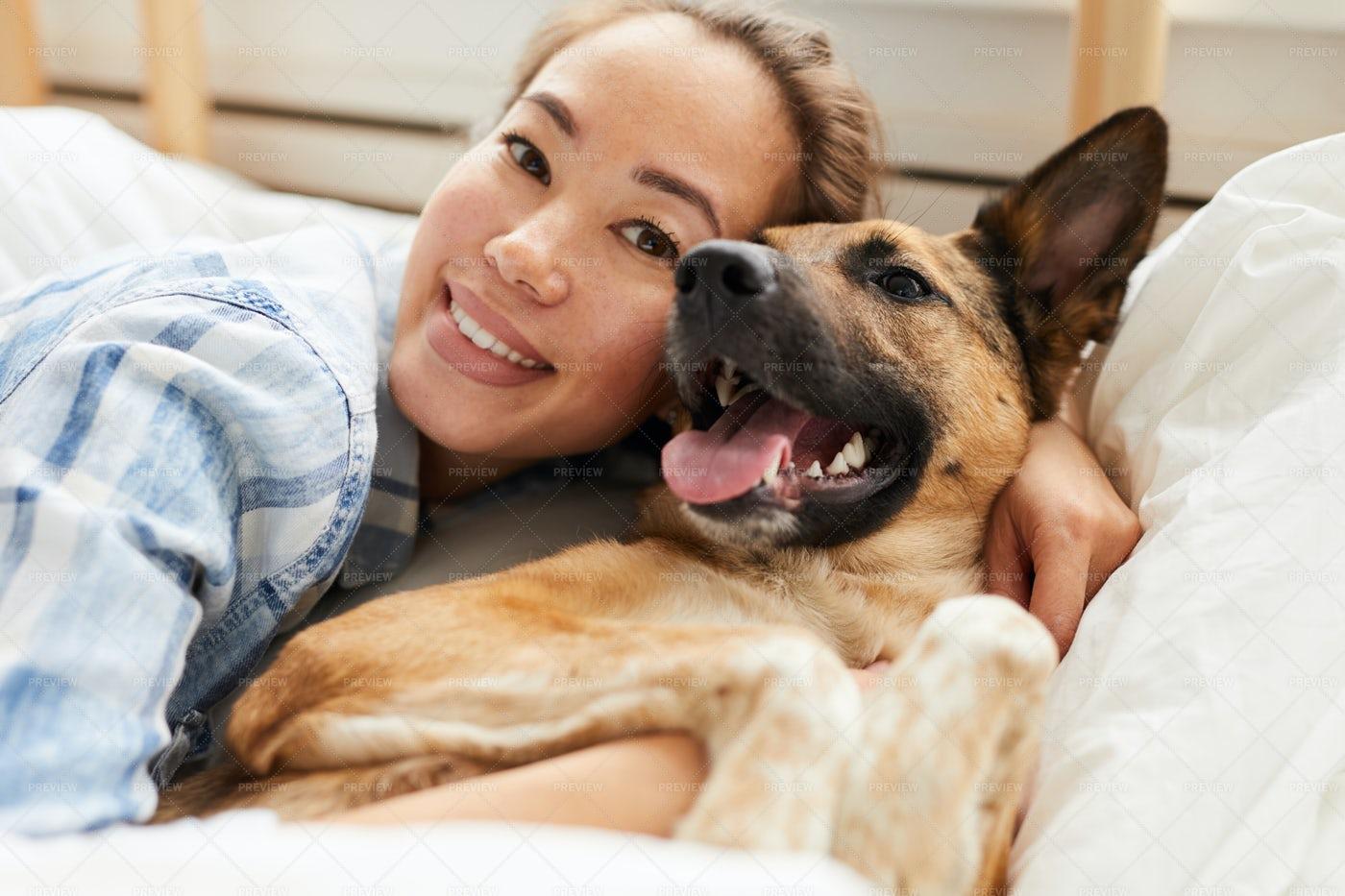 Beautiful Asian Woman Hugging Dog: Stock Photos