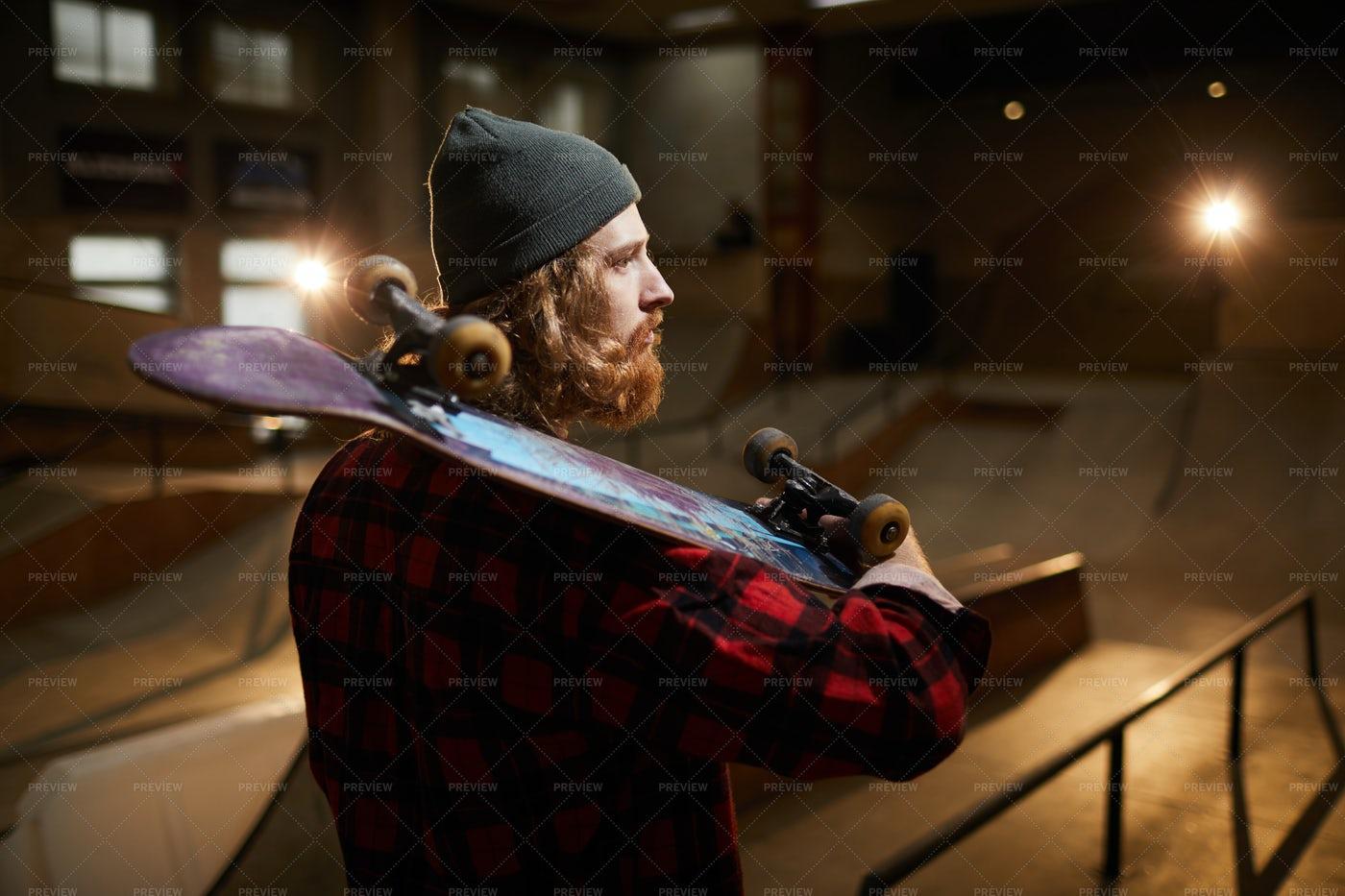 Bearded Man Holding Skateboard: Stock Photos