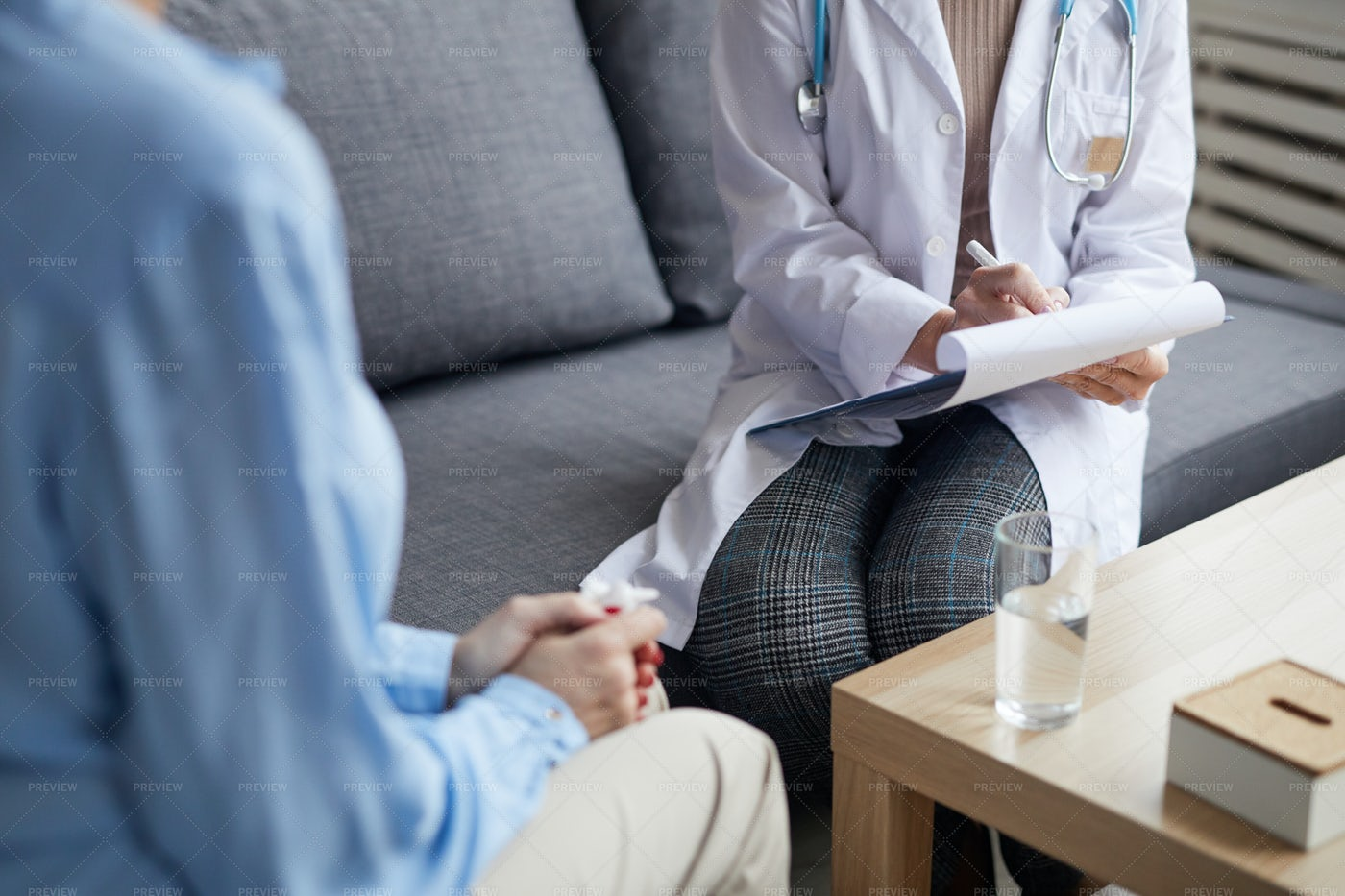 Female Doctor Writing On Clipboard: Stock Photos