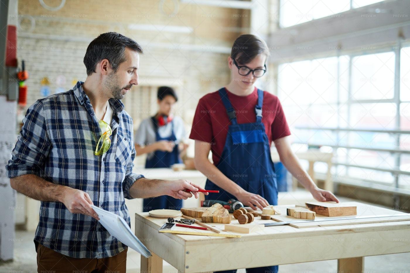 Carpenter Giving Advice To Student: Stock Photos
