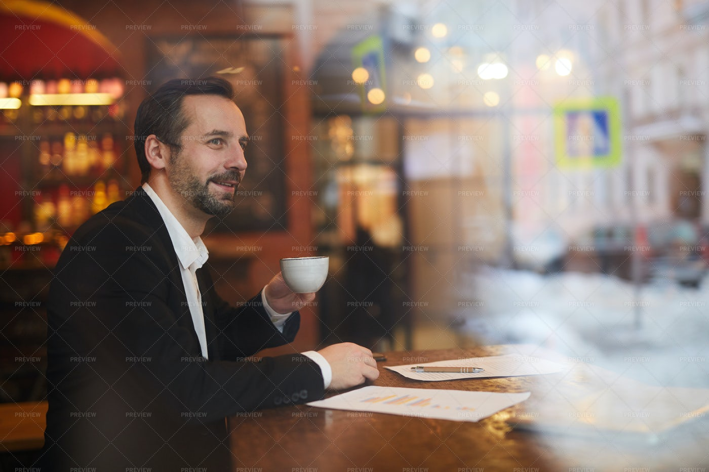 Pensive Businessman In Cafe: Stock Photos