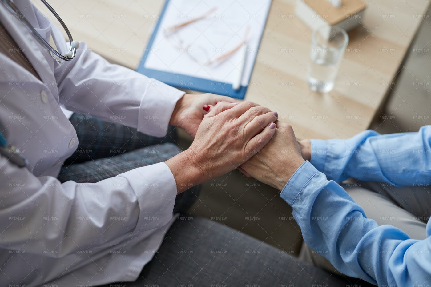 Caring Female Doctor Holding Hands...: Stock Photos