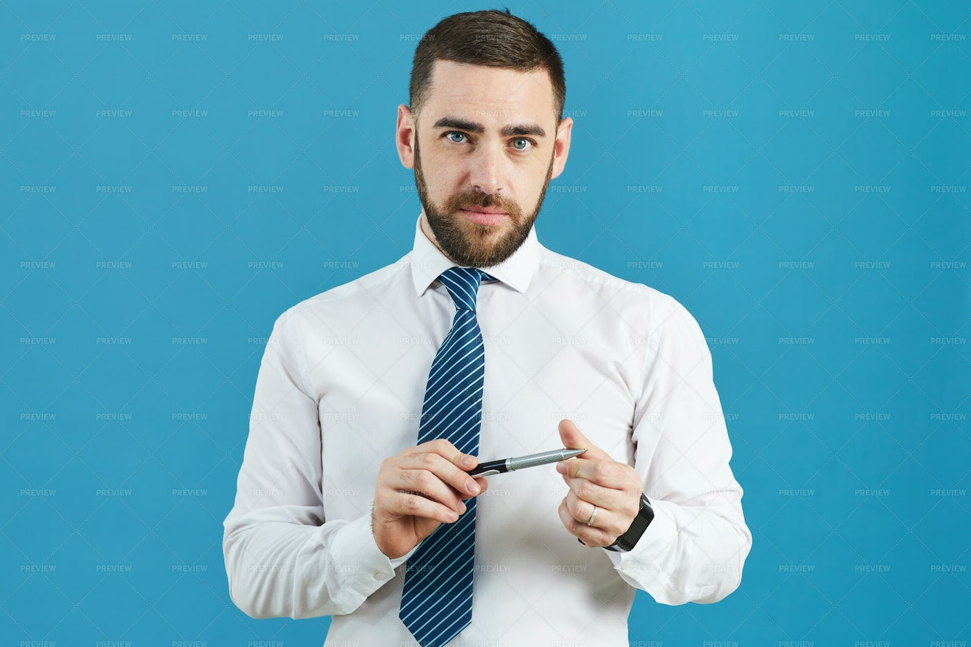 Business Analyst Twisting Pen: Stock Photos