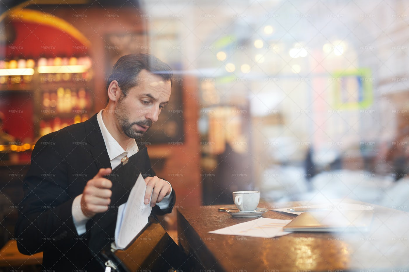 Businessman Leaving Cafe: Stock Photos
