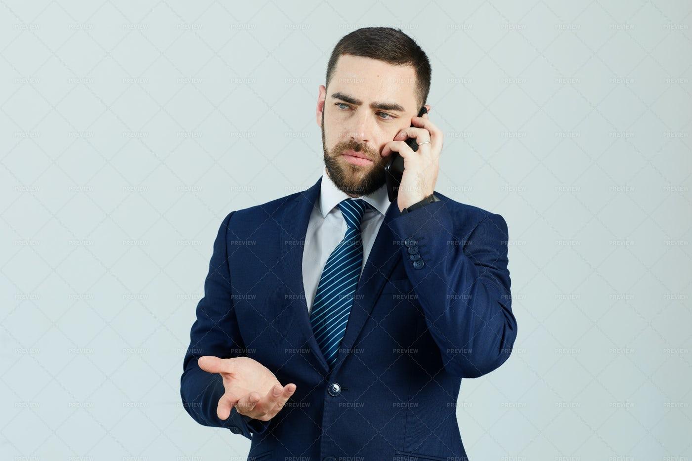 Displeased Businessman Talking: Stock Photos