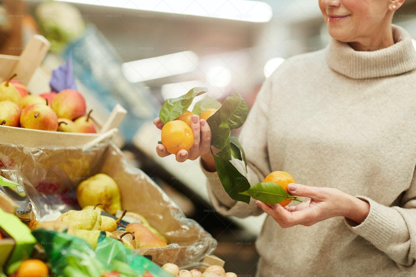Woman Choosing Fruits At Farmers...: Stock Photos