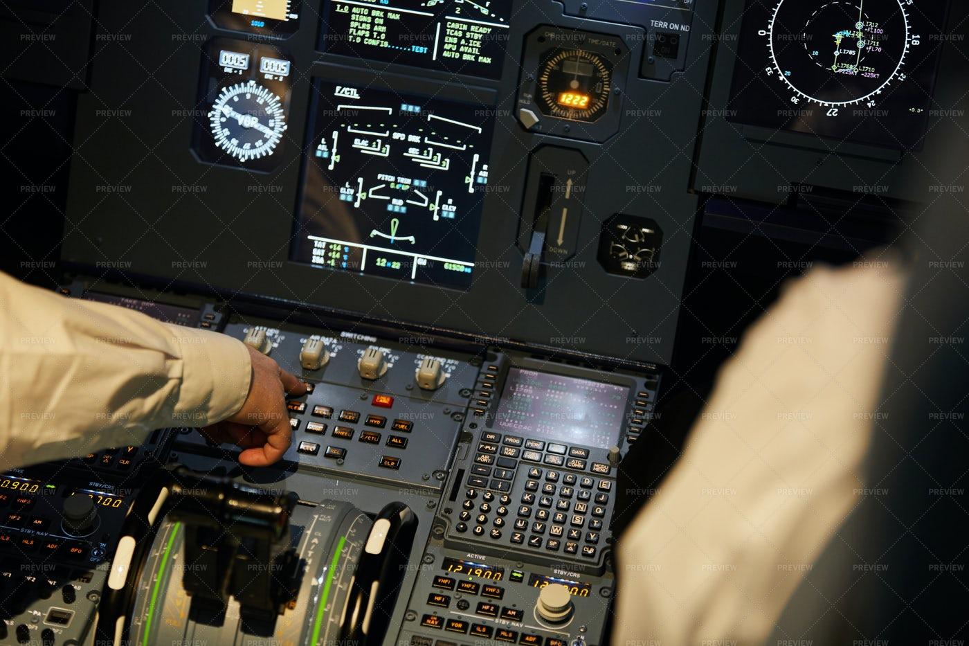Aviators Checking Engine Systems: Stock Photos
