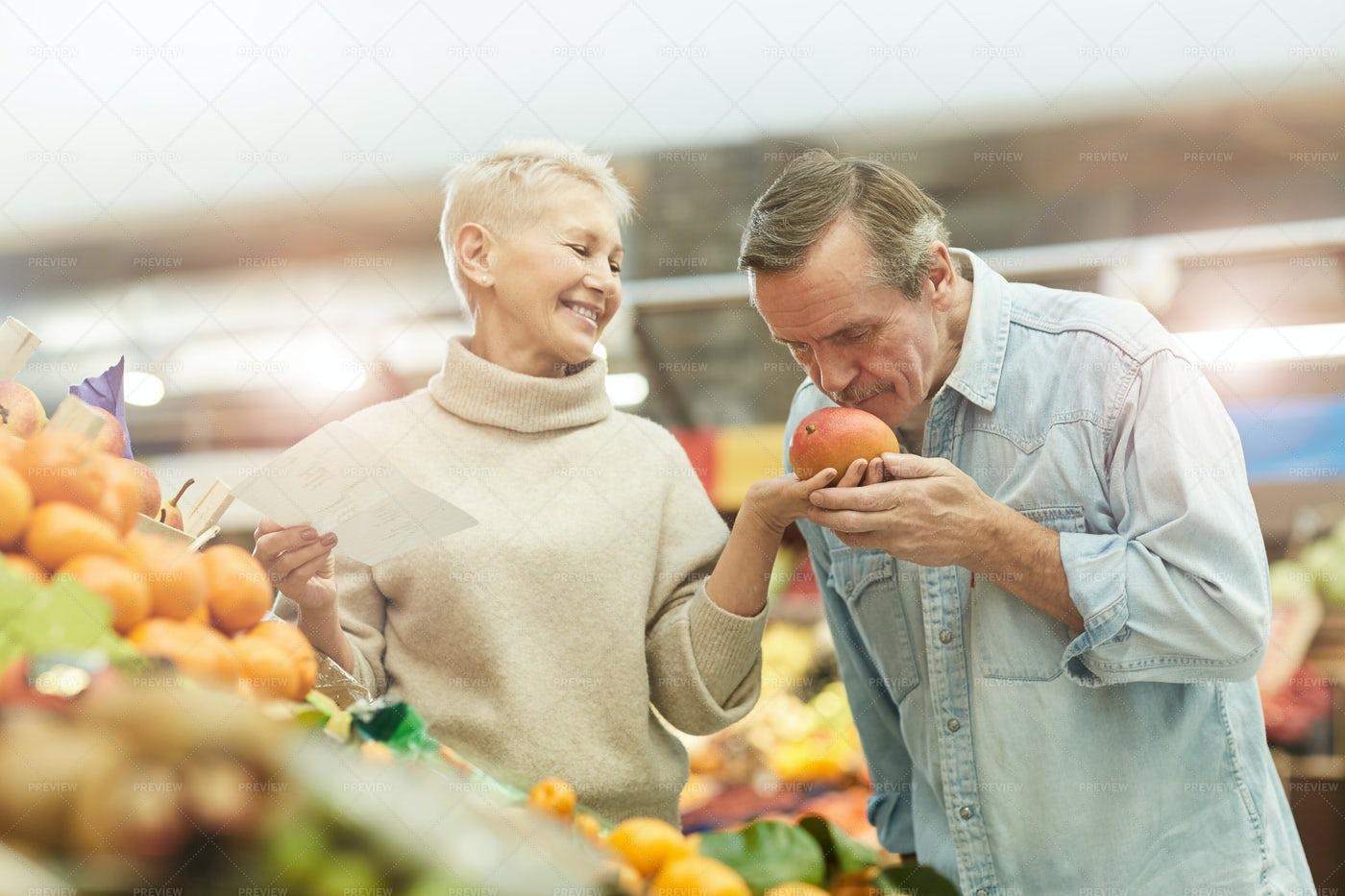 Senior Couple Choosing Fruit: Stock Photos