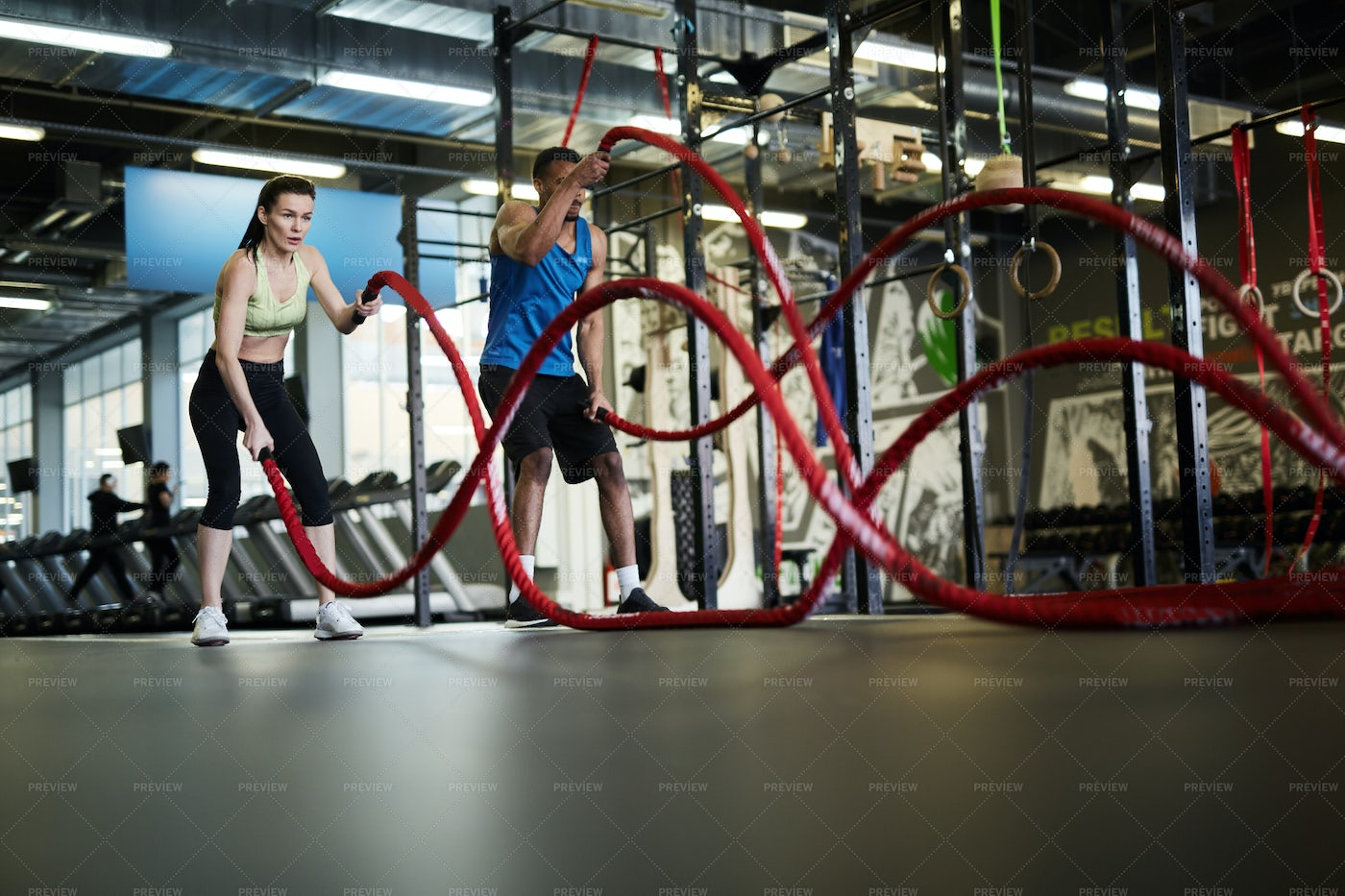 Couple Training With Battle Ropes: Stock Photos