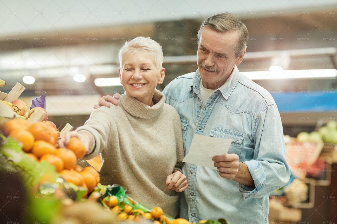 Senior Couple Choosing Fresh Fruits: Stock Photos