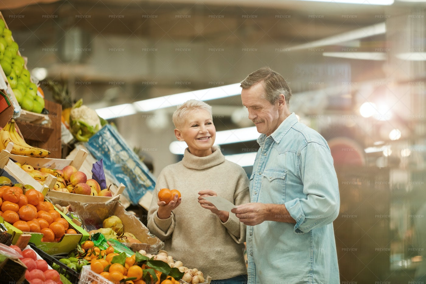 Senior Couple At Farmers Market: Stock Photos