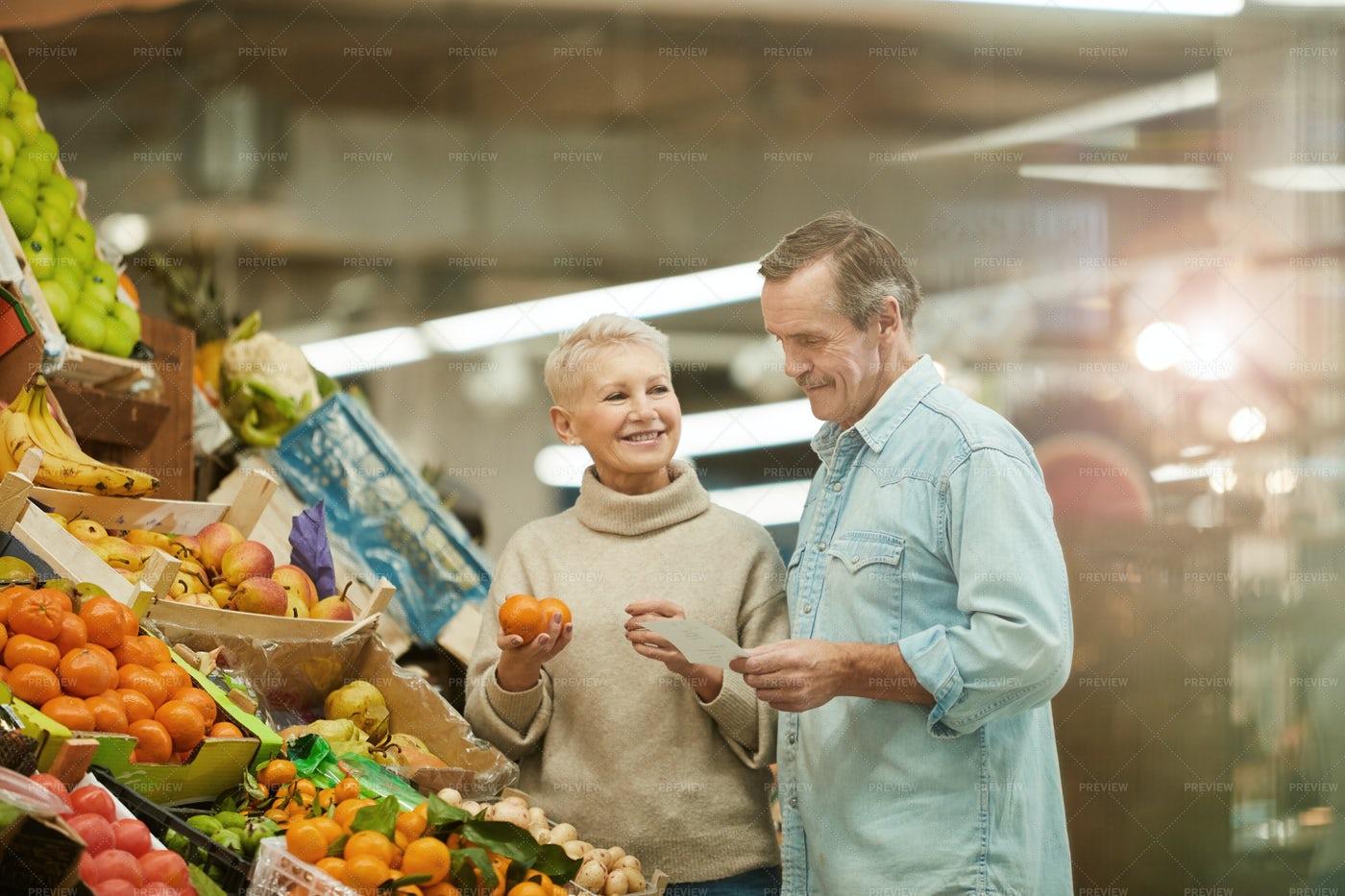 Senior Couple At Farmers Market: Stock Photos