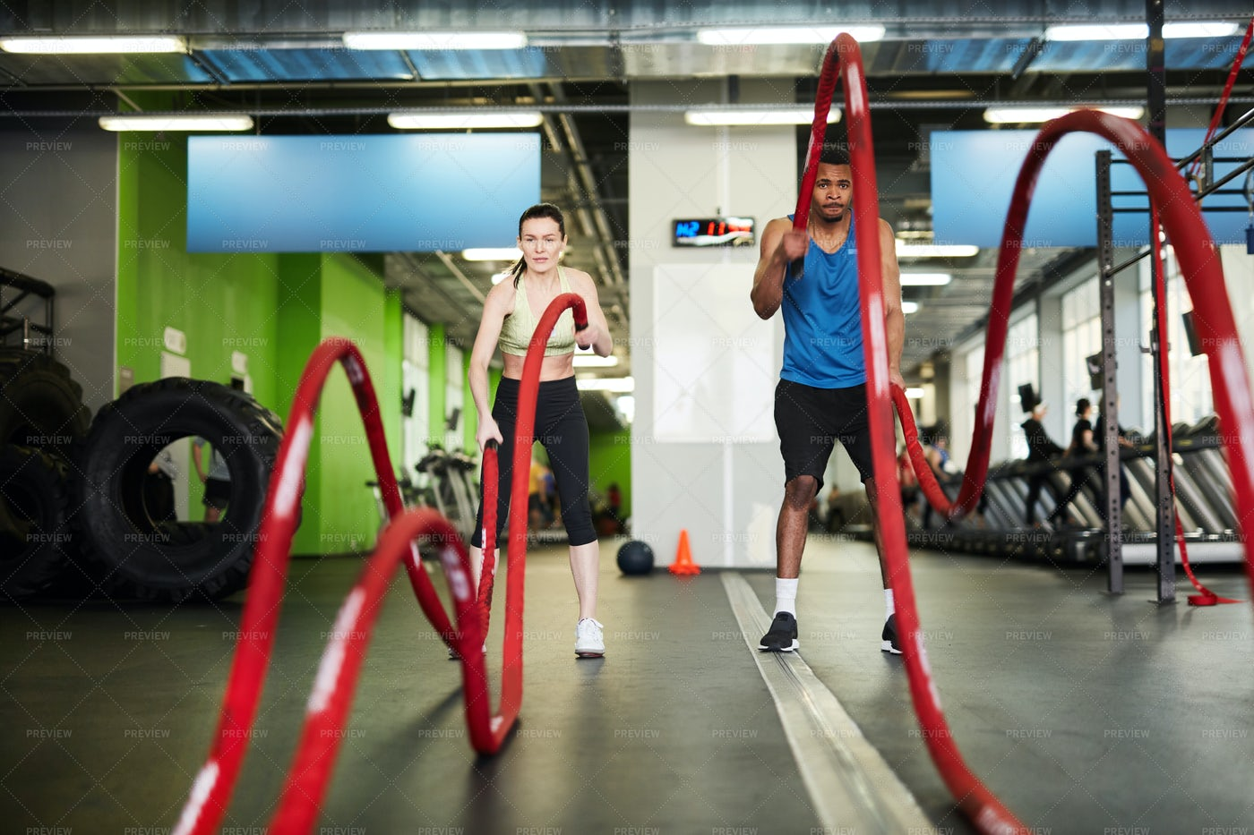 Couple Working Out With Battle...: Stock Photos