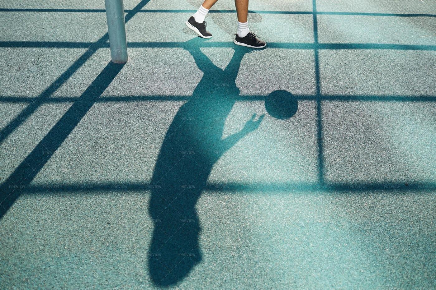 Shadow Of Basketball Player: Stock Photos