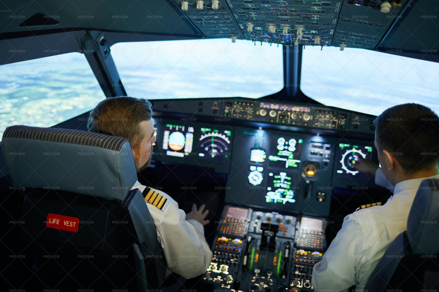 Pilots Discussing Airplane Position: Stock Photos