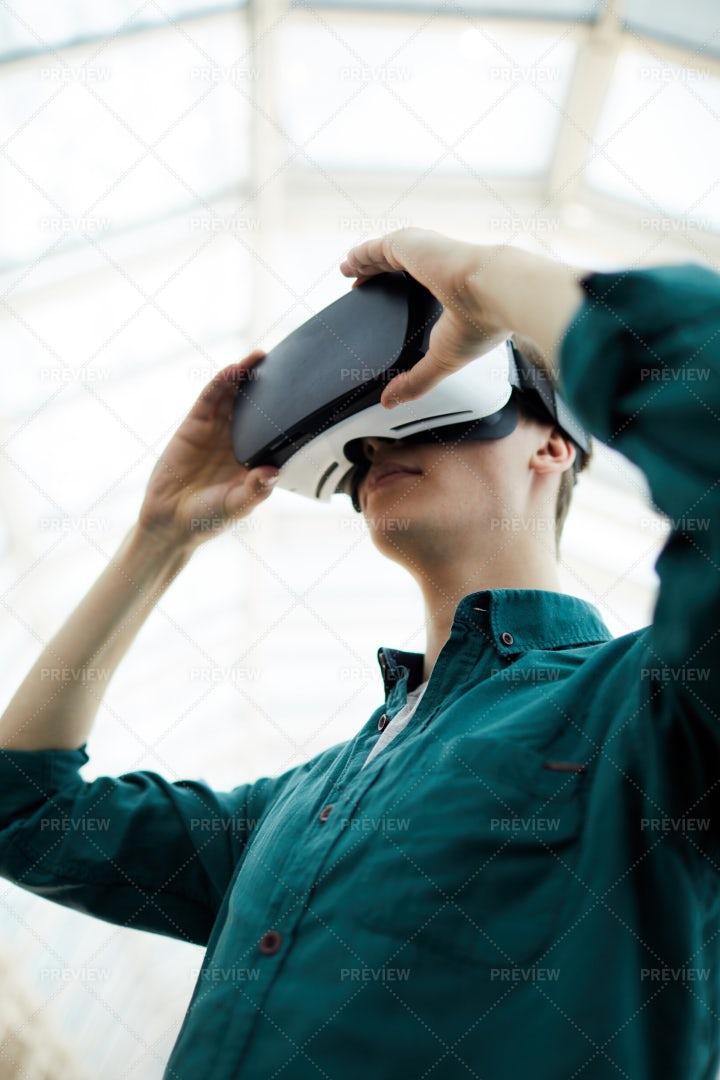 Young Man Using VR: Stock Photos