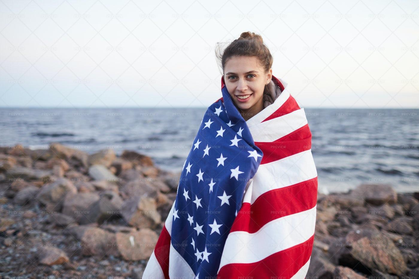 Woman Strolling Over Rocky Shore: Stock Photos