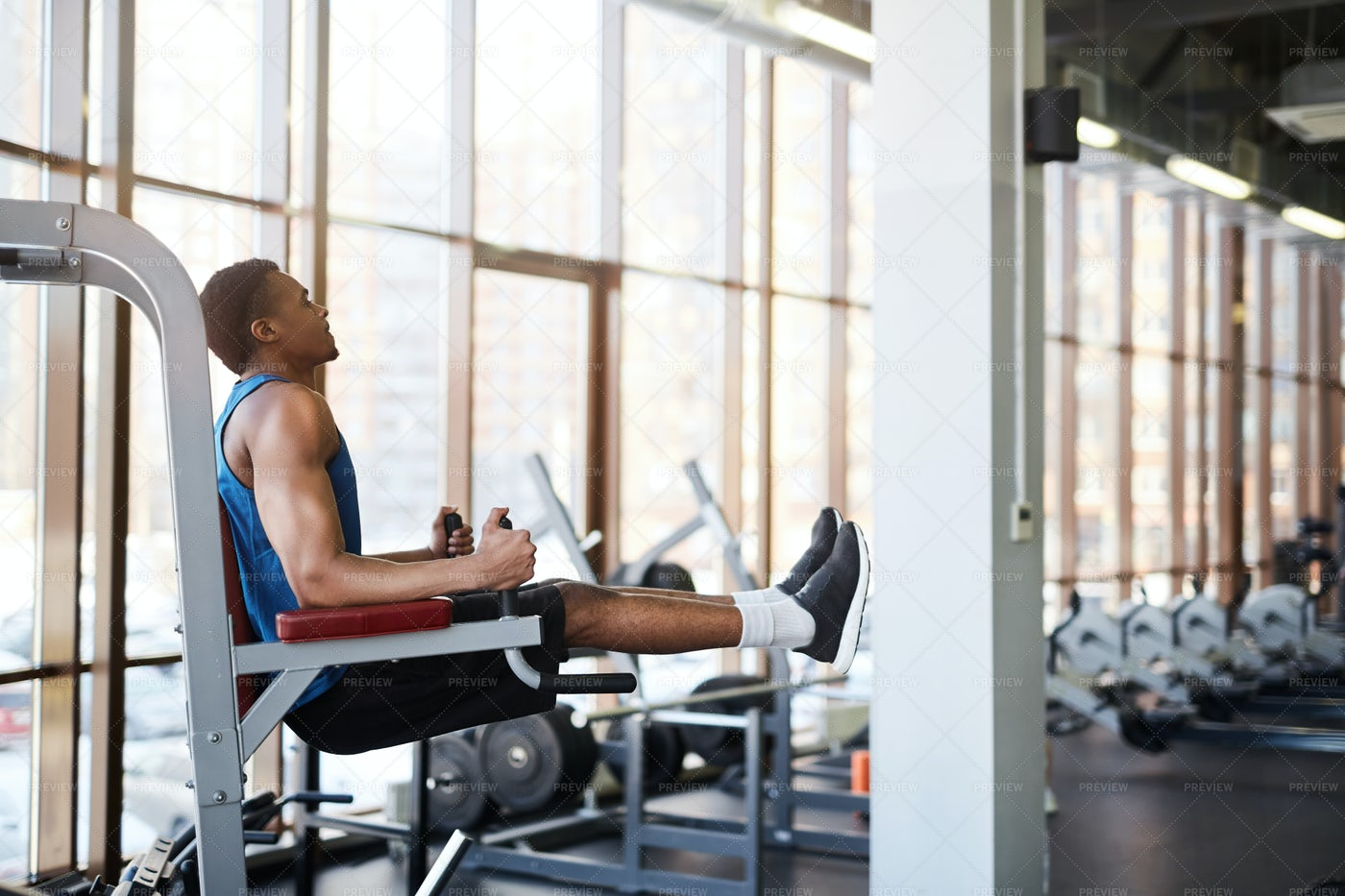 Muscular Man Using Machines In Gym: Stock Photos