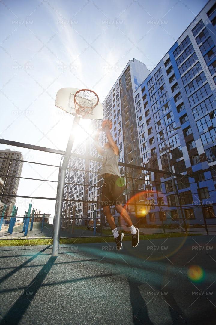 Basketball Player Dunking: Stock Photos