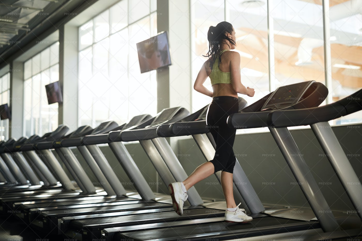 Young Woman Running On Treadmill: Stock Photos