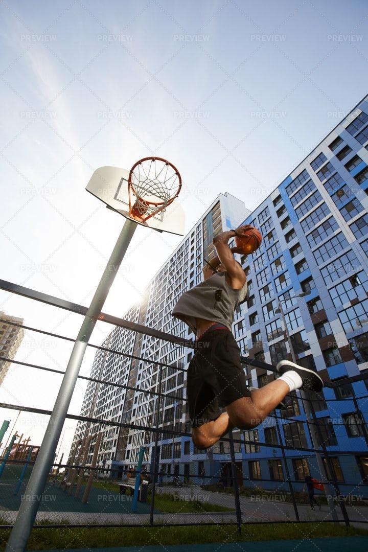Basketball Player Dunks: Stock Photos