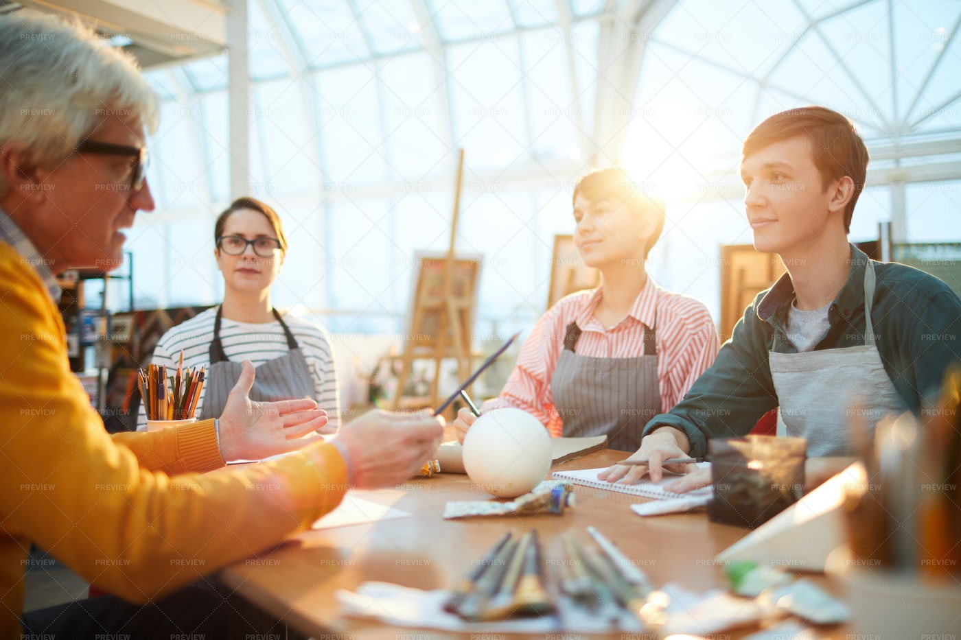 Art Students At Table: Stock Photos