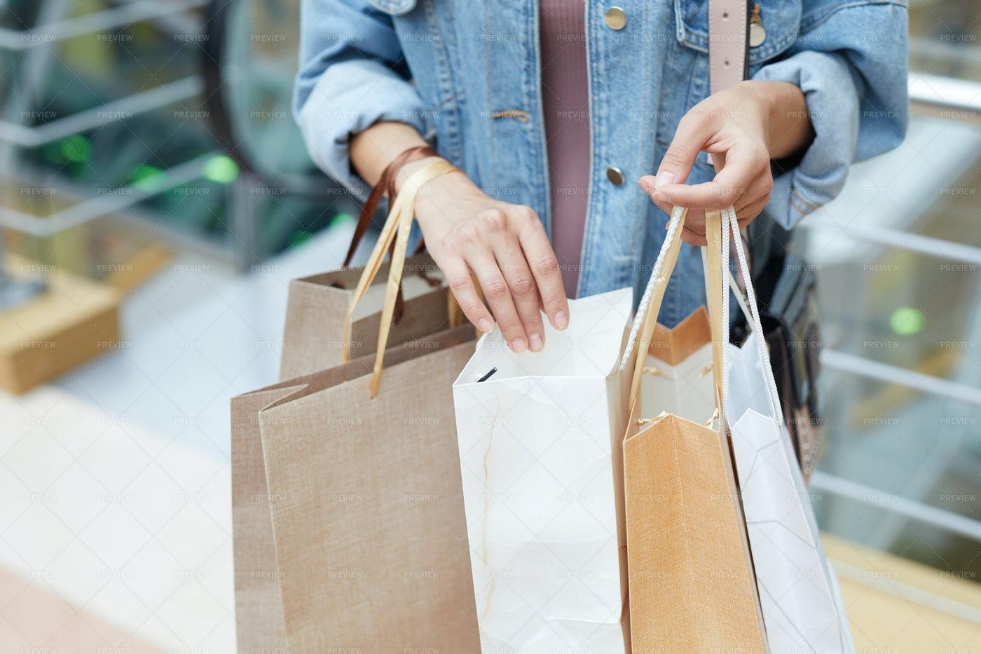 Looking Through Shopping Bags: Stock Photos