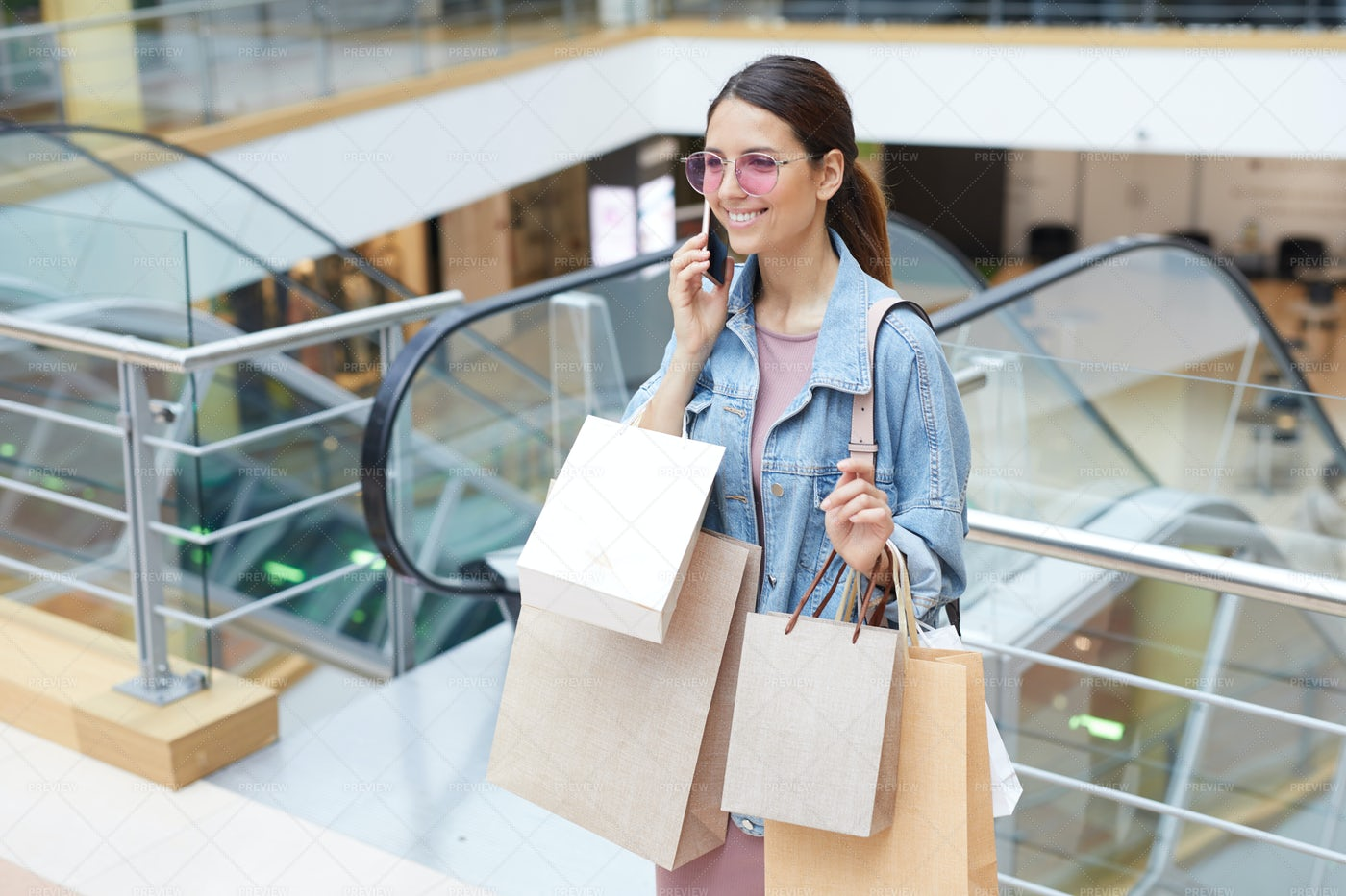 Calling Friend After Shopping: Stock Photos