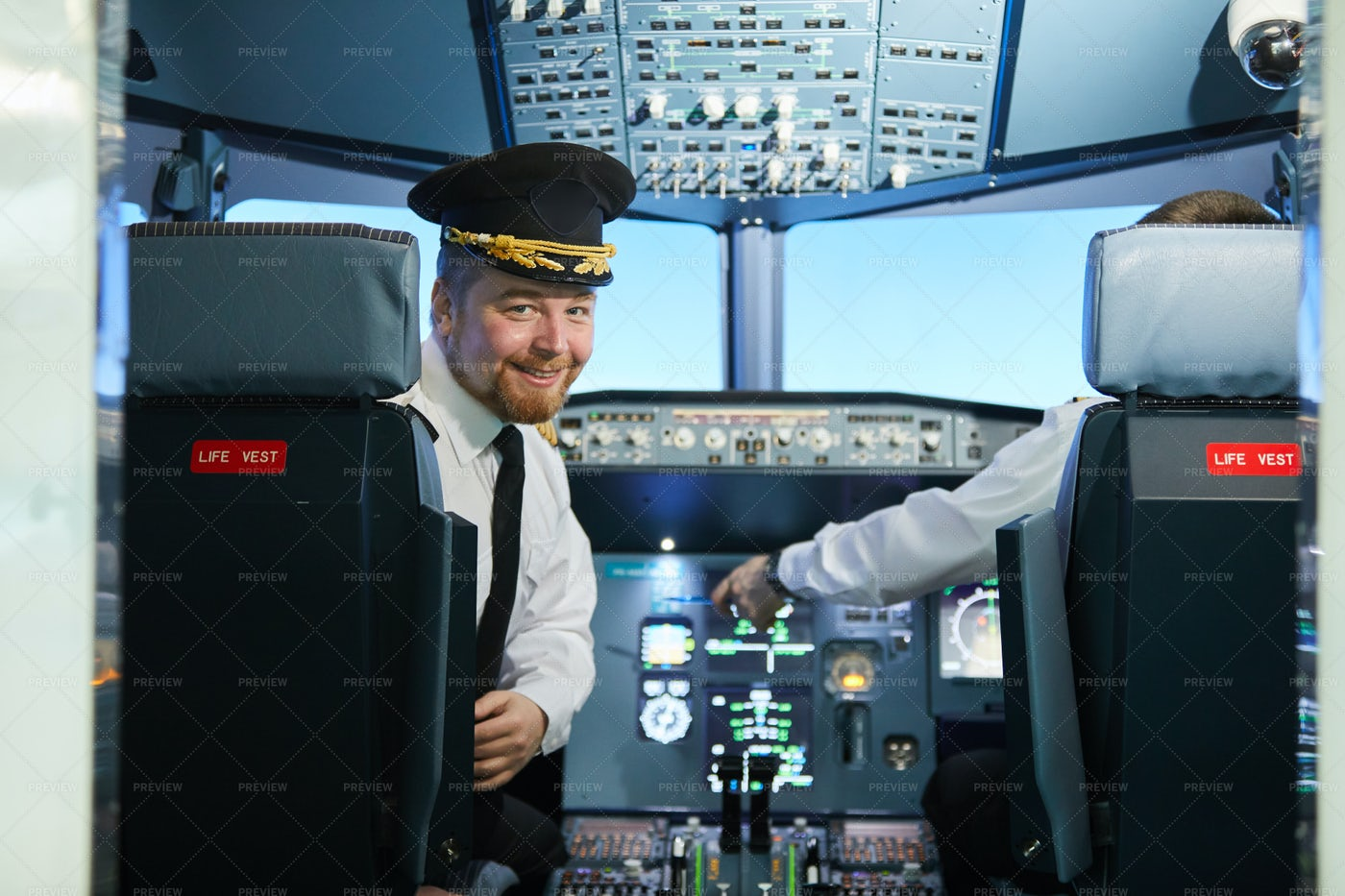 Smiling Bearded Pilot In Cockpit: Stock Photos