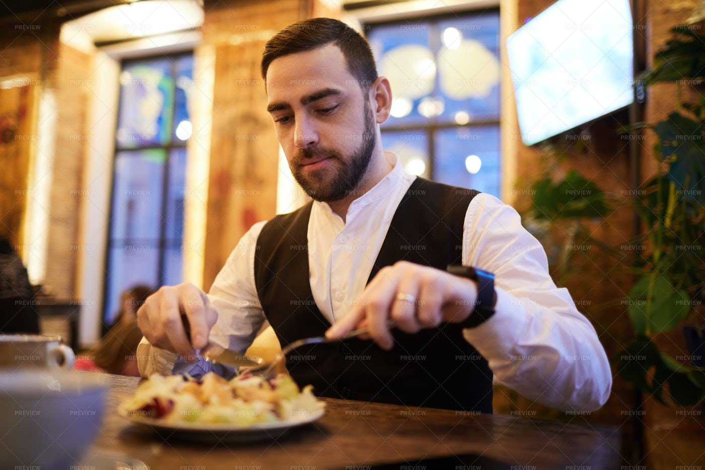 Businessman Eating In Cafe: Stock Photos
