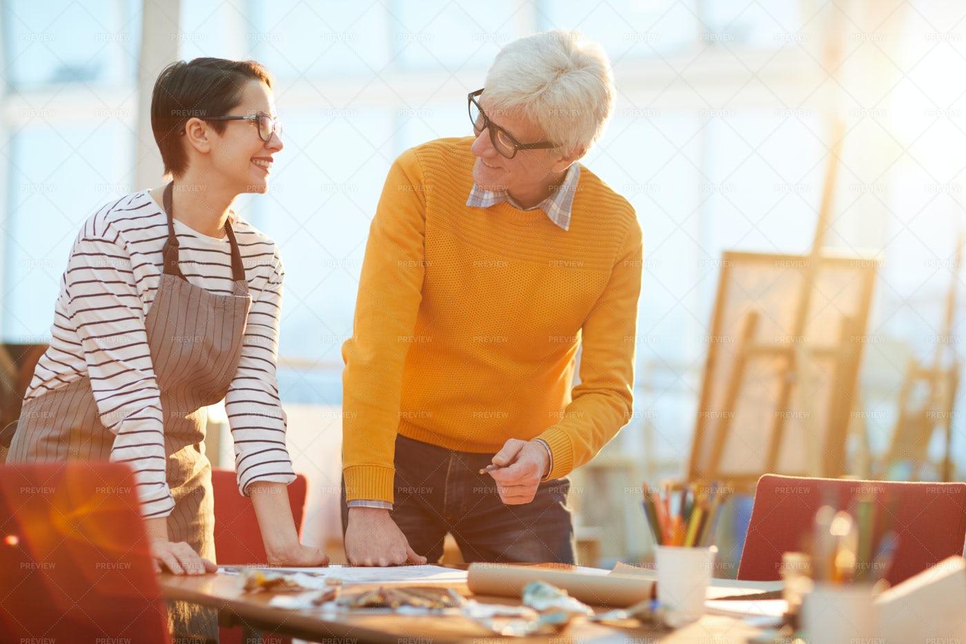 Senior Art Teacher Works With Student: Stock Photos