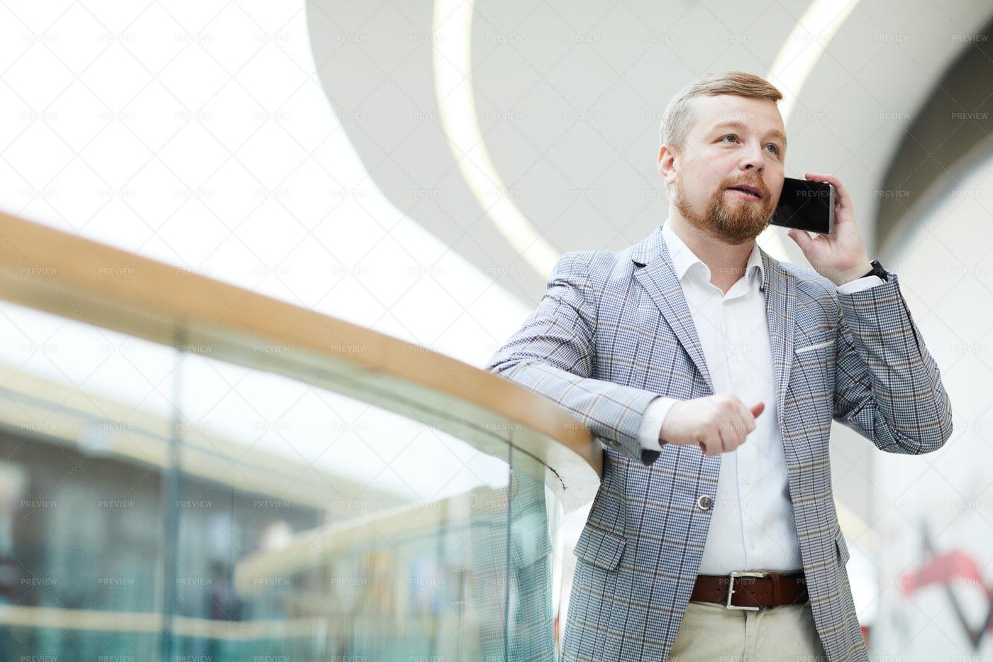 Busy Entrepreneur Talking On Phone: Stock Photos