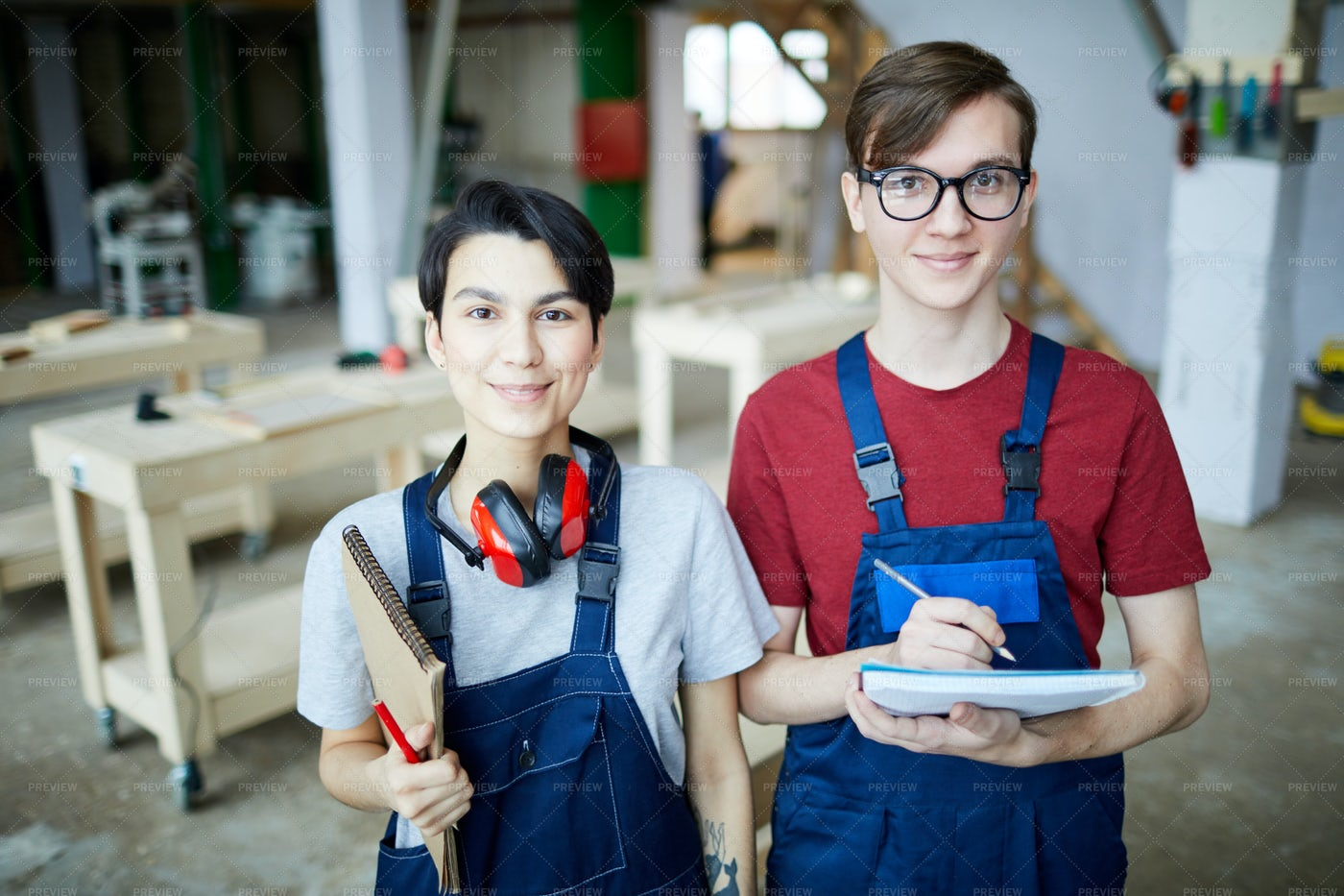 Carpentry Students In Workshop: Stock Photos