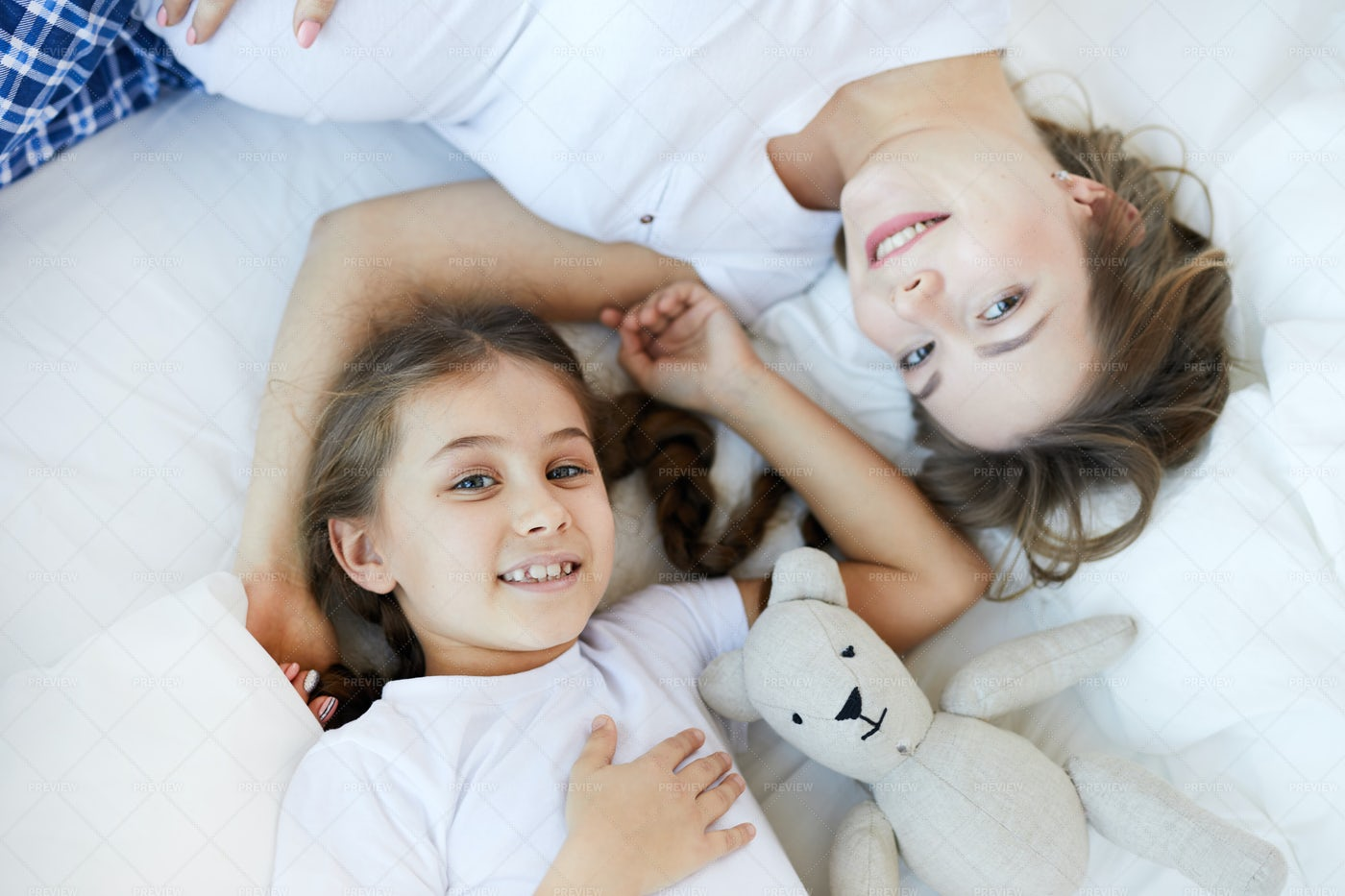 Mother And Child On Bed Above View: Stock Photos