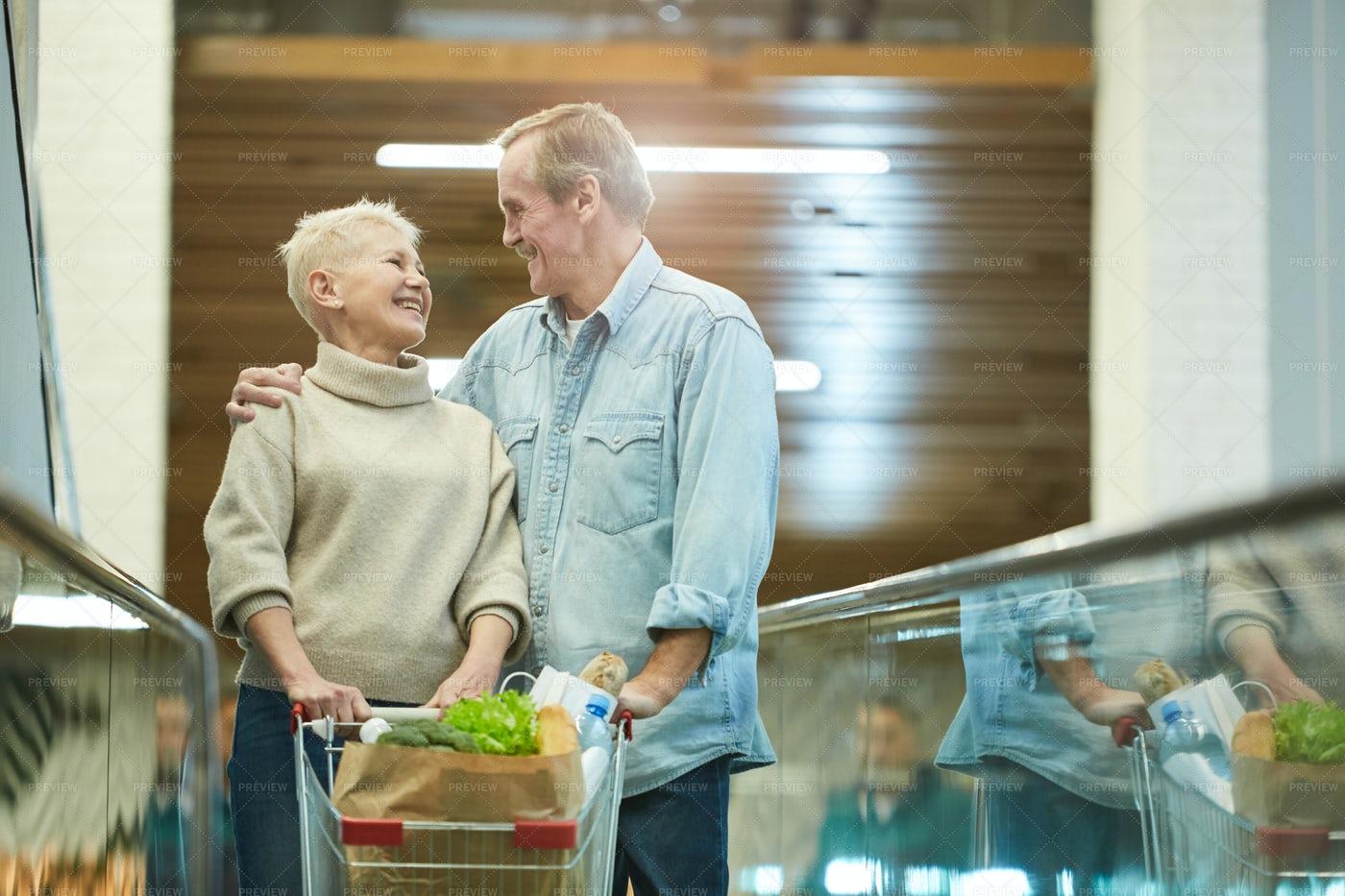 Smiling Senior Couple Shopping: Stock Photos