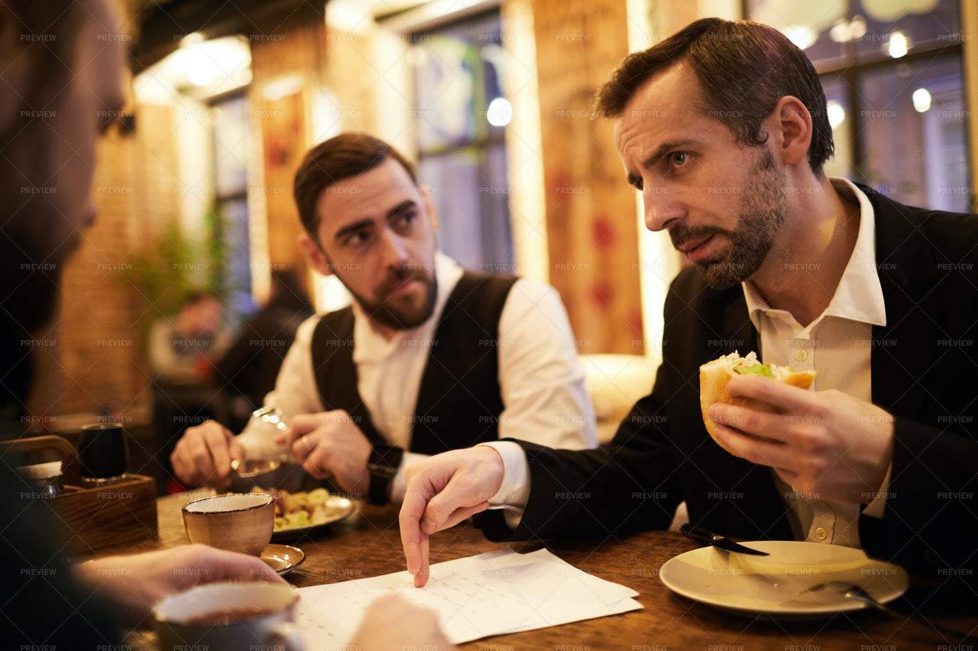 Two Business People In Restaurant: Stock Photos