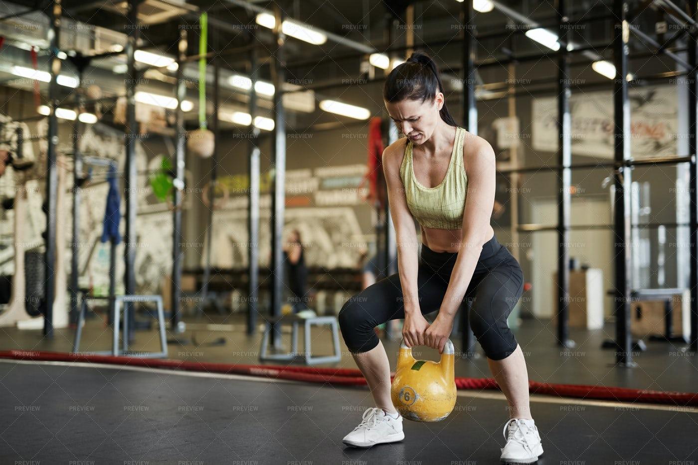 Strong Woman Lifting Weights: Stock Photos